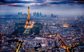 The Eiffel Tower. A picture containing outdoor, sky, valley. Paris is one of the top fashion cities in Europe.