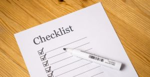 Making a checklist to prepare for the upcoming international move.