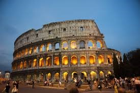 A group of people standing in front of a Colosseum in Rome. Italy is not just a country of fashion and shopping.