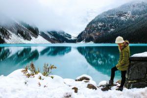 A women standing next to a frozen lake