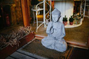 Statue of Buddha on a doorstep.