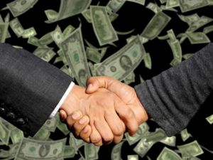 Handshake and money - something that will happen after moving to Holly Springs