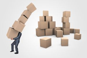 A person carrying some boxes, you need to label your boxs to make your relocation fast