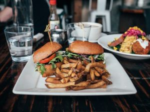 two vegan burgers and fries