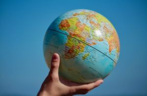a hand holding a globe because there are many places you can go after leaving Europe