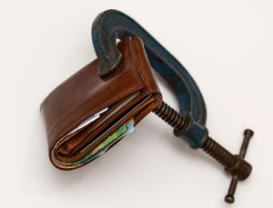 a wallet squeezed because you need to set the budget carefully for emergency moving