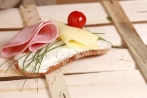A simple sandwich representing a customary lunch box that is a staple of life in Norway.