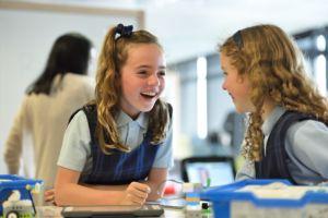 School girls laughing.