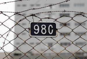 A fence with an address number.