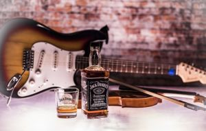 Jack Daniel's whiskey and musical instruments are symbols of Nashville.