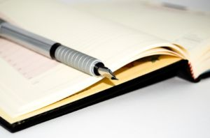 A notebook and a pen you can use to organize the whole process when moving into a smaller space.