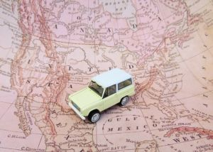 A car on a map symbolizing moving from Russia to America.
