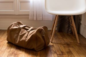 A travel bag on the floor.