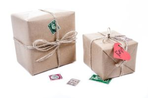 Two boxes, nicely wrapped in paper with loving notes attached to them.