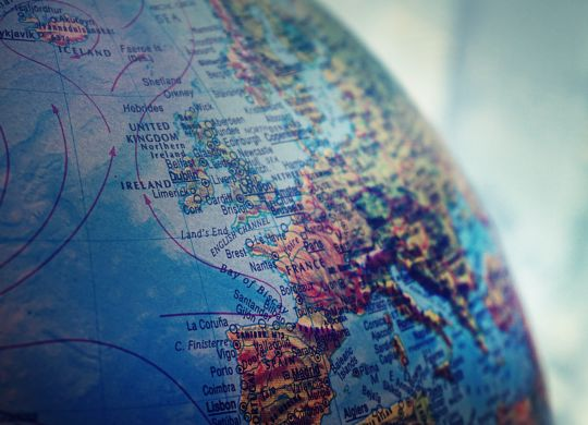 A close-up of a globe and Europe on it. After moving, you will experience culture shock in Europe.