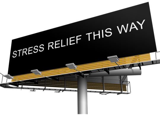 A sign that says - stress relief this way