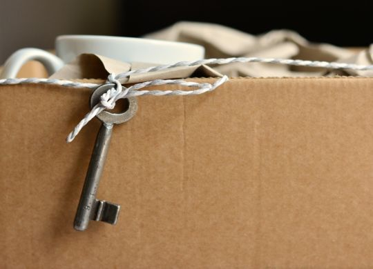 Moving box and hanging key.