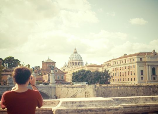 A person taking a photo and thinking about moving to Rome