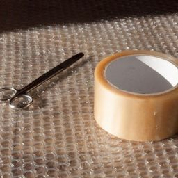 Plastic wrapping material, scissors and a duct tape, useful if you want to ensure your bulky furniture's safety.