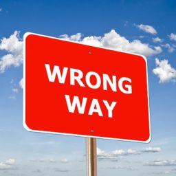 A street sign saying wrong way.