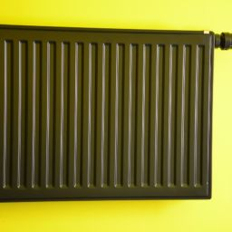 A radiator on a yellow wall.