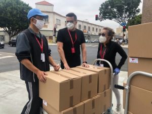 three people packing for moving to Europe after coronavirus