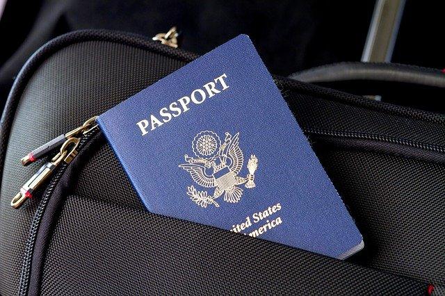 A blue passport in a trolley bag.