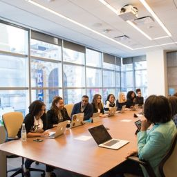 A busines meeting in a conference room.
