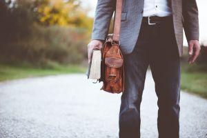A man holding a bag.