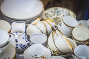 Ceramic mismatched teacups as a part of everything you should get rid of before moving