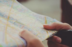 A person looking at a map where you can find some of the best Florida cities for foreigners.