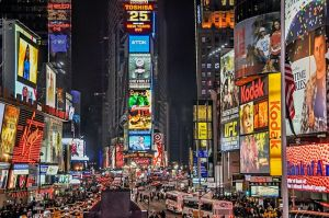 There is a crowded street during night as busy streets are one of the things every foreigner needs to know about NYC before the move.