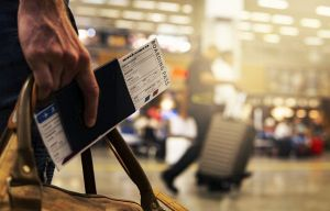Suitcase, passport, and boarding pass. These are the things you need when planning to see top 5 U.S. states you should visit next year.